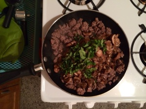 Step 3: Everything back in the skillet to mix with the fresh herb (basil, in this case).